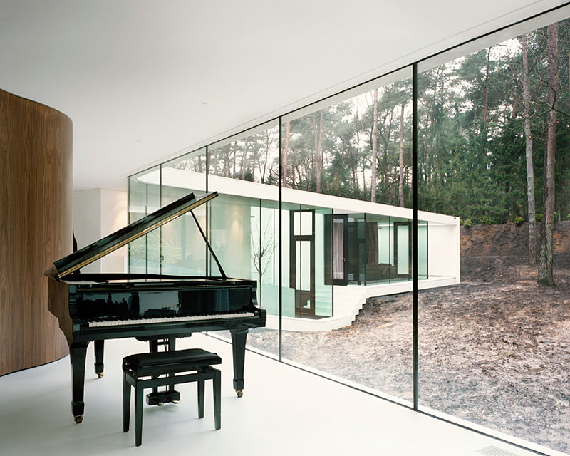 Phenomenal modern forest home that will attract you in ede for Classic house piano