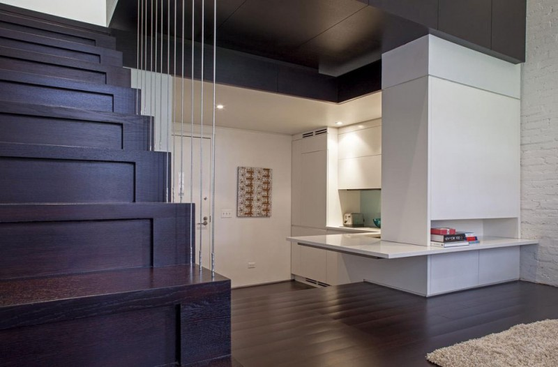 Beautiful Layout in Manhattan Micro Loft Design Installed with White Themed Painting and Wooden Striped Floor