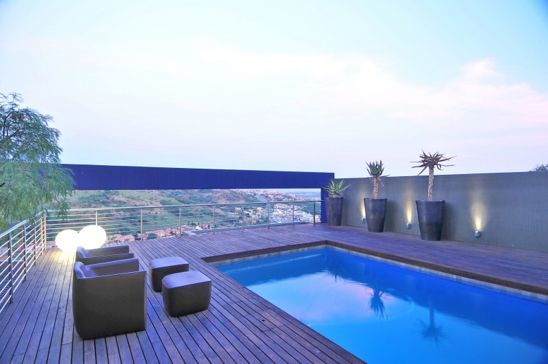 Charming Blue Sky Views from Swimming Pool Beautified with Double Lounge and Foot Rest in House Tat Residence