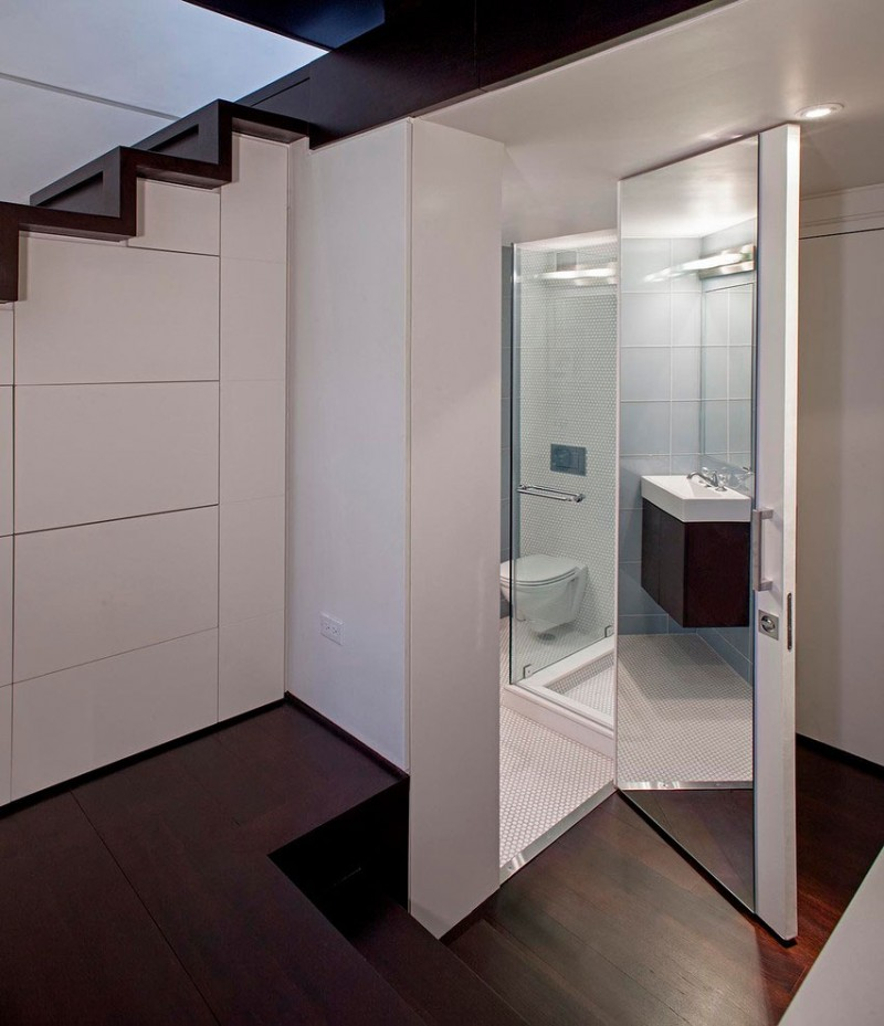 Cool White Painted Wall for Bathroom in Manhattan Micro Loft Design with White Wooden Glass Door