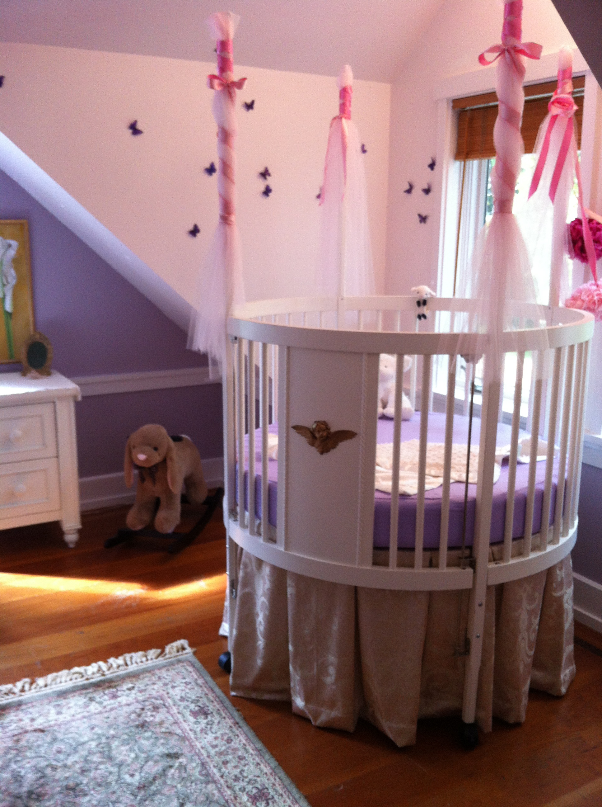 cute white round crib idea completed with purple mattress and metallic