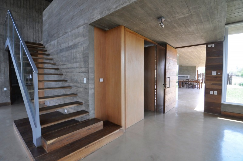 Spacious concrete home inspired by km house housebeauty for Exposed concrete walls interior