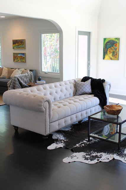 Elegant Chesterfield Sofa With Cushions On Its Sections