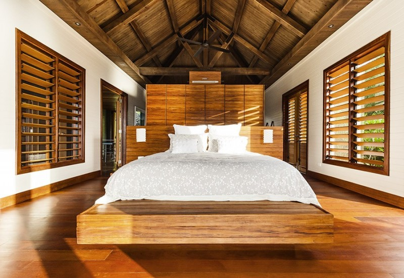 Interesting Wooden Striped Centre Wall for Bedroom of the Korovesi Home Completed with Wooden Bed and Ottomans