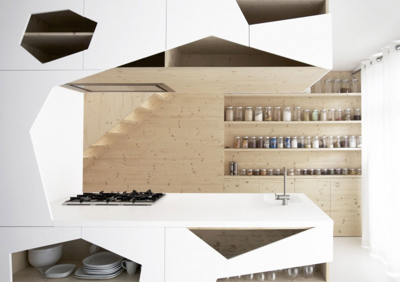 Modern Minimalist Home Geometric Kitchen Corner with Efficient Cabinet Modern Wood Staircase Small Canisters on Wood Wall Shelves