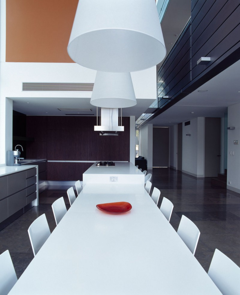 Sleek Kitchen Table Design Ideas with Red Plate Under the Big Pendant Lamps Decor at the Sensory Interior Delight Residence