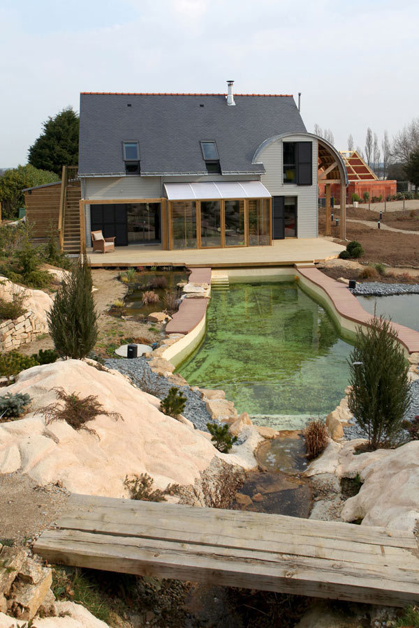 Stylish Grey Painted Two Story French Eco Friendly House Building featured with Clear Irregular Swimming Pool