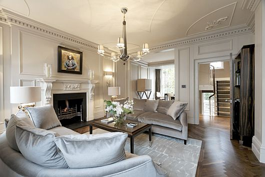 Tempting Family Room Design Applied in Belgravia Property in London with White Curved Sofas and Big WHite Cushions on Glossy Wooden Floor