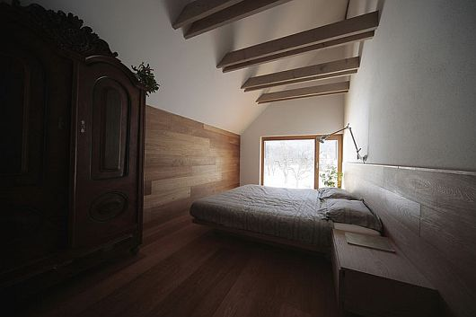 Unique Bathroom Decorated with White Bed and Wooden Dresser and Large Shelf in 6x11 Alpine Hut by Ofis Architects