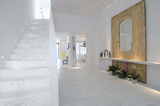 White Staircase Decorated with Built in Lamps on Inner Stair String of Exquisite All White Sotogrande House