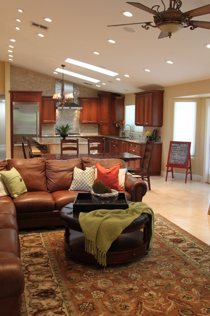 Wonderful Sectional Leather Sofas Design at Classic Living Room with Round Coffee Table and Floral Carpet Area