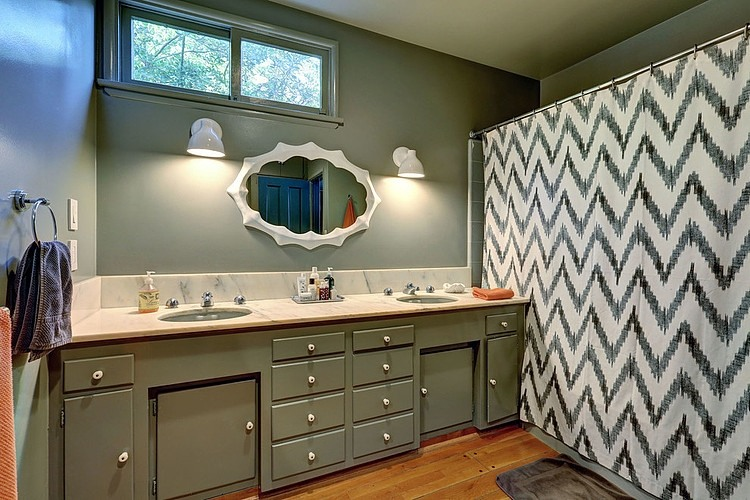 Stunning Bathroom Design Inside the Modern Ranch House with Green Painted Vanity and Chevron Curtain Shower