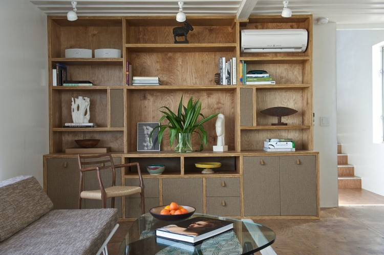 Stylish Floor to Ceiling Wooden Cabinet Designed to Display Open Shekves and Closed Cabinets inside Tim Palen Studio