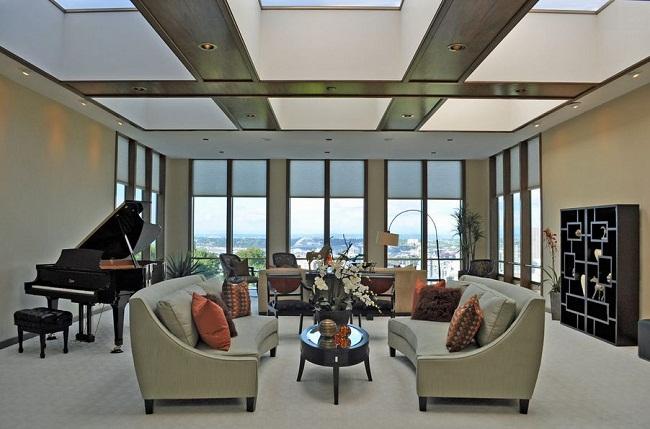 Piano Living Room Natural Light Sky Windows and Curved Sofa