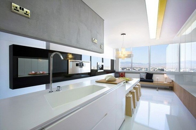 White Countertop in the Kitchen Interiors with Large Windows