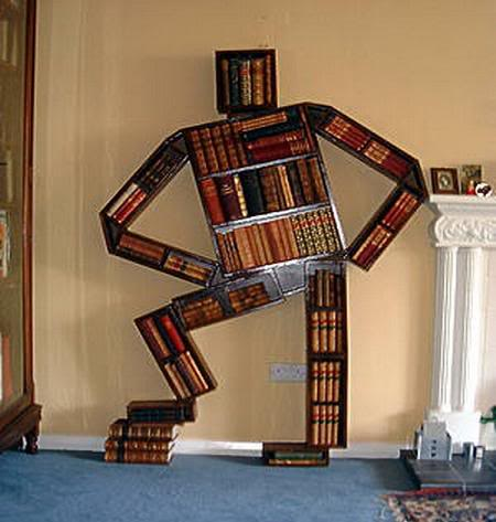 Man as book shelf stand
