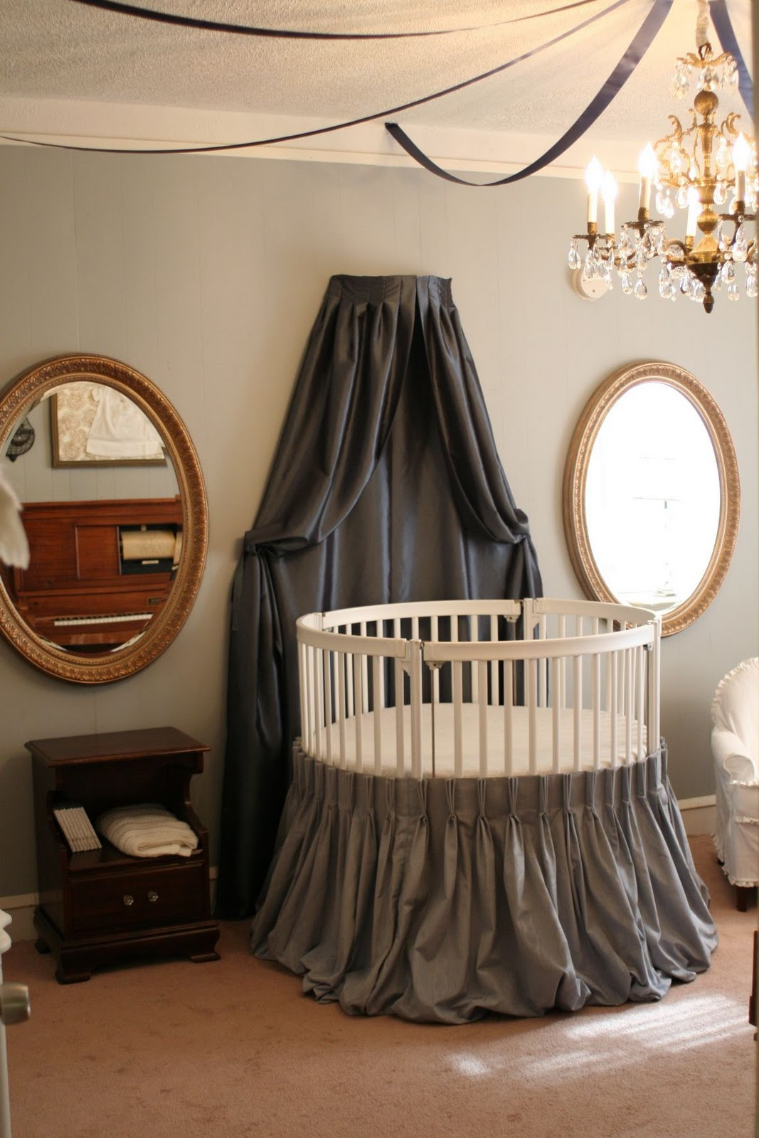 Adorable Round Crib Decorated By Vintage Ornaments In