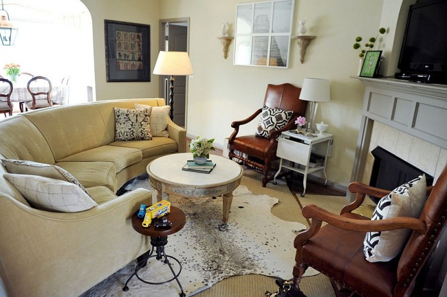 Small Traditional Living Room Curved Sofa and Cowhide Rug