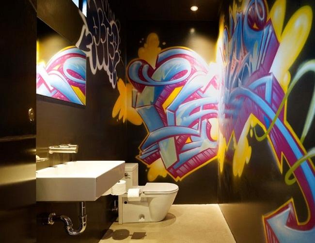 Black Bathroom with Graffiti On Walls