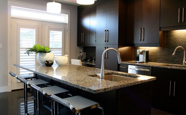 Deep Chocolate Modern Kitchen with Stone Countertop